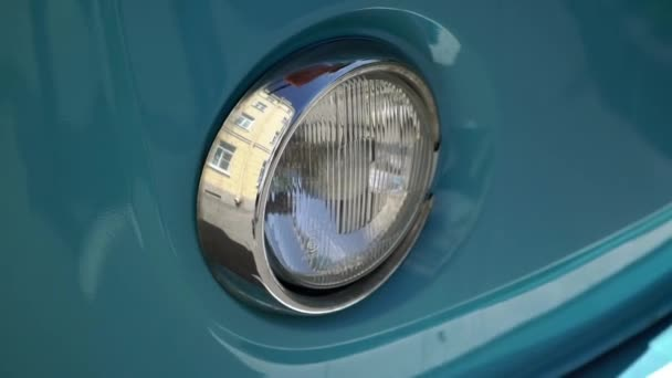 Headlight of blue retro bus