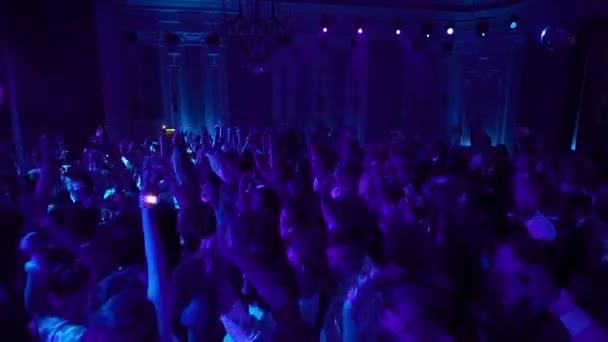 SAINT-PETERSBURG, RUSSIA - JUNE 28, 2018: Young people dancing at concert