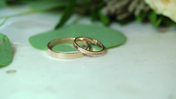 Two golden wedding rings on marble background