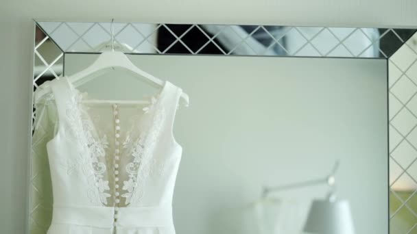 Wedding dress on a mirror in bedroom at luxury hotel