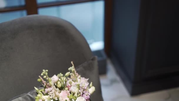 Bridal wedding flowers bouquet on gray chair
