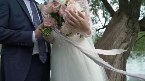 Happy bride and groom on their wedding hugging