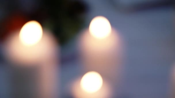 Blurred background with candles light. Holiday candle flame. Burning candles.
