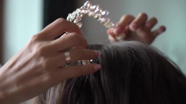 Bridal make up and hairstyle. Royal crown with crystals and diamonds
