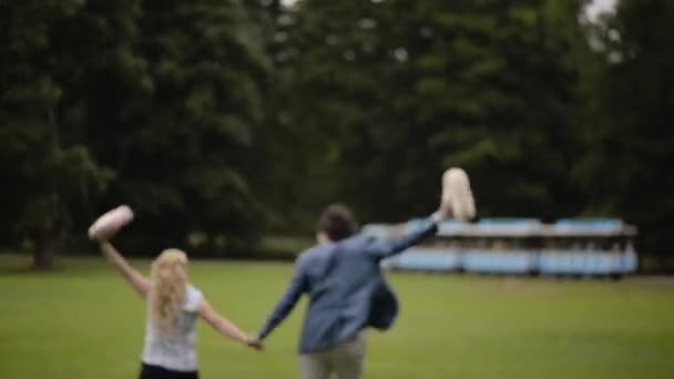Young lovely couple have fun in a park in summer. Romantic dating or lovestory.