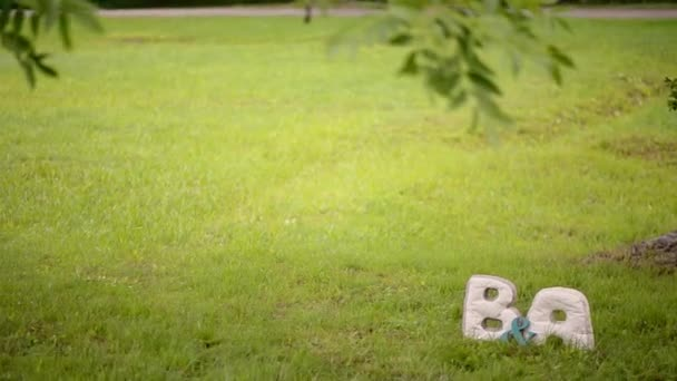 B and A letters in a park at the lawn