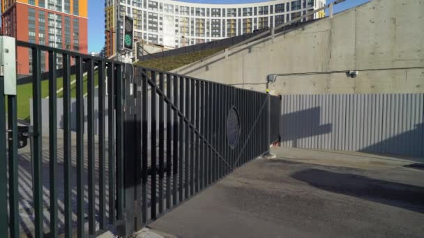 Gates for car in a big apartment building in a city opening