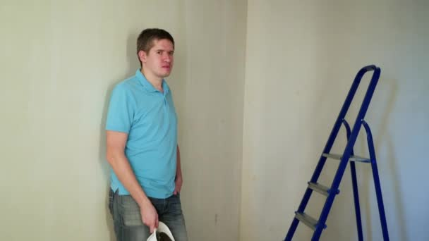 Worker at construction site renovating flat