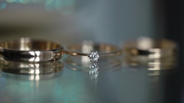 Wedding rings on a glass background