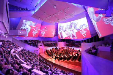 MIAMI, FLORIDA - JAN 20, 2018  The New World Symphony celebrates 7 years of creating audiovisual performances with projections on the concert hall sails stock vector