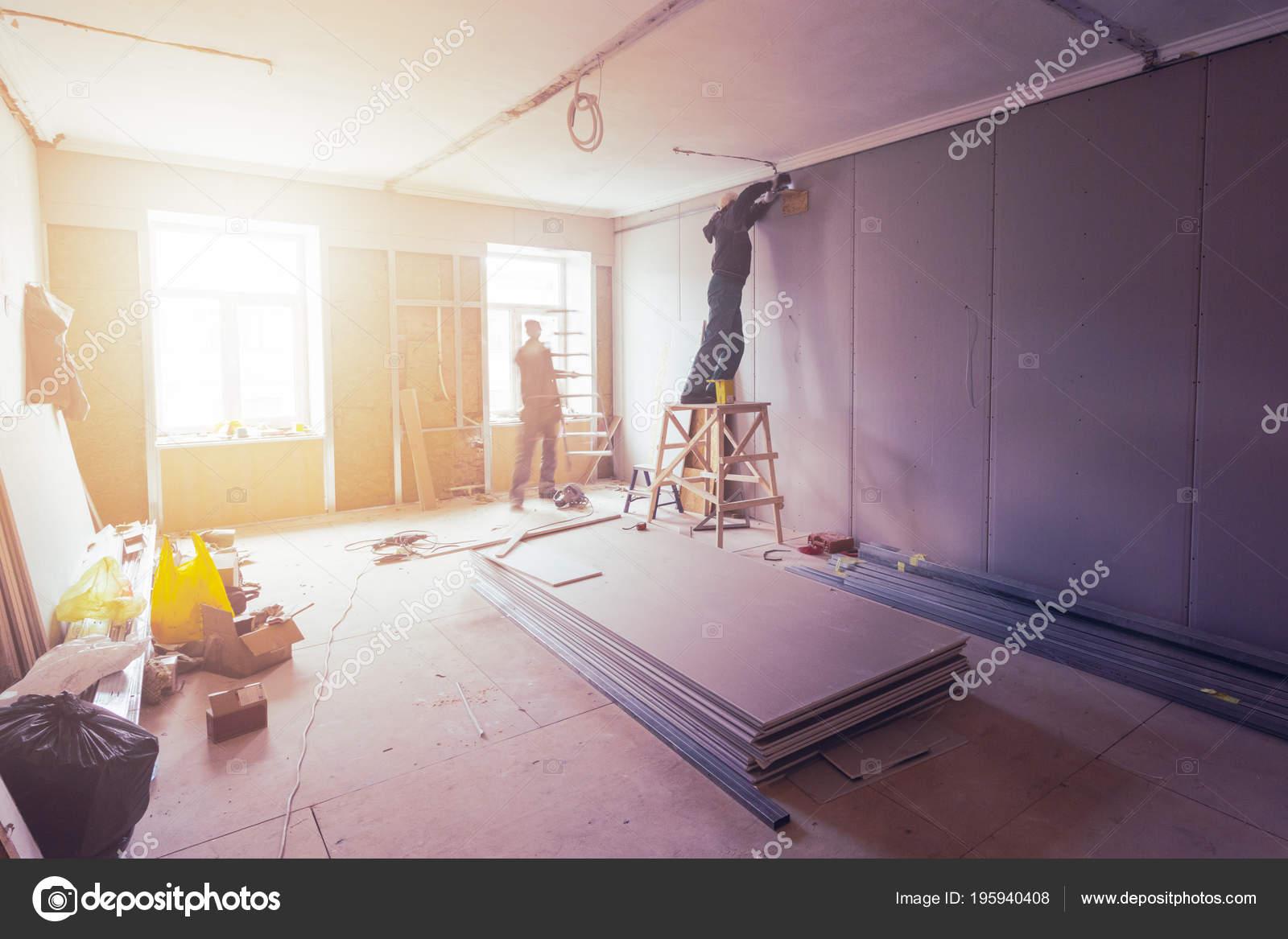 Workers Installing Plasterboard Drywall Gypsum Walls