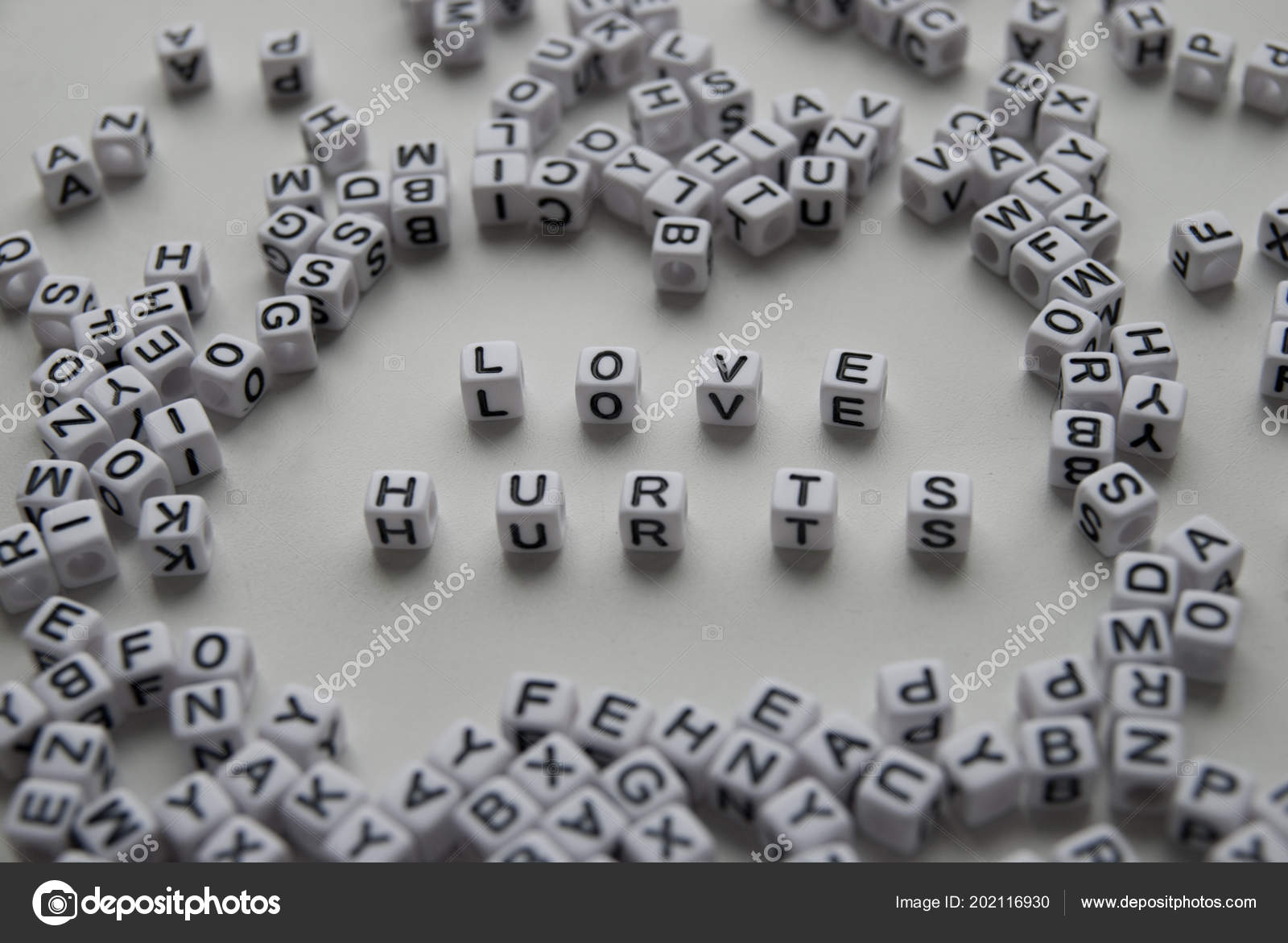Love Hurts Word Written On Cubes On White Background Creative Text
