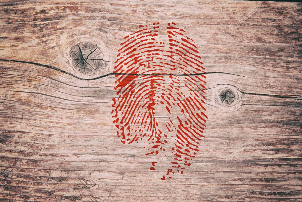 Blood Fingerprint image on the wooden background. Crime murder Texture
