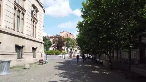 Bucharest, Romania - June 20, 2020:  4k video of walking in Old Town or Old Center in Bucharest, Romania. Lipscani street walking with people, old architecture, people at terraces enjoying a vacation