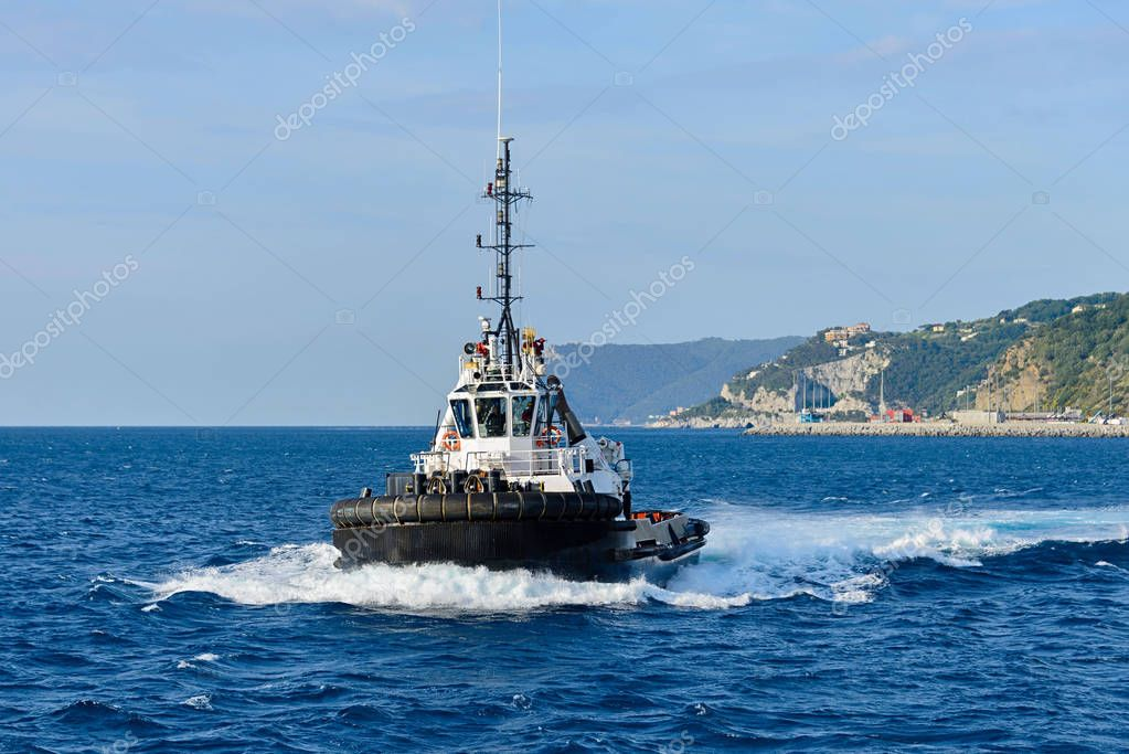 Tug boat with towing rope