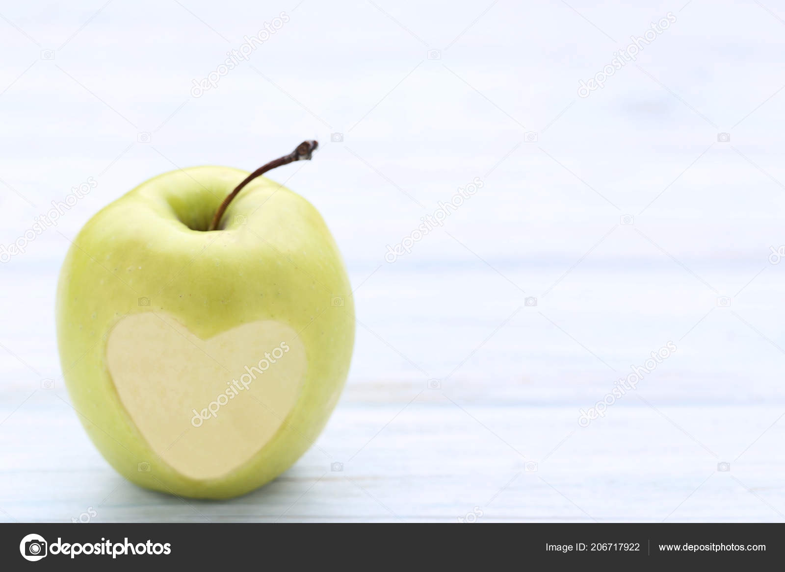 Green Apple Cutout Heart Shape Wooden Table Stock Photo