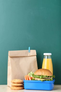 School lunch with paper bag on chalkboard background stock vector