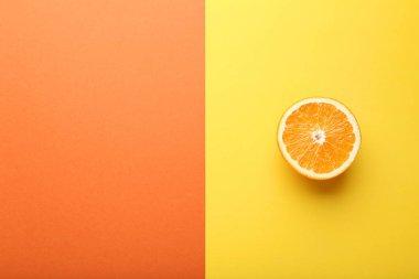 Half of Orange fruit on orange and yellow background stock vector