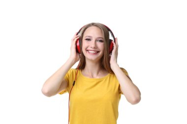 Young woman with headphones on white background