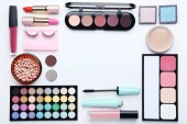 Fotografie Different makeup cosmetics on white background