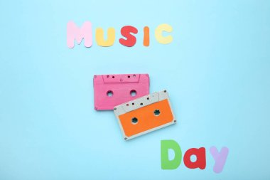Cassette tapes with inscription Music Day on blue background