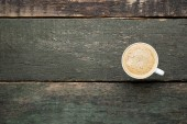Fotografie Cup of coffee on grey wooden table