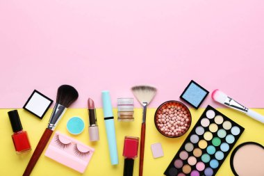 assortment of makeup cosmetics on colorful background