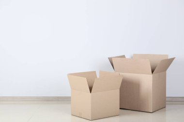 two opened cardboard boxes on grey background