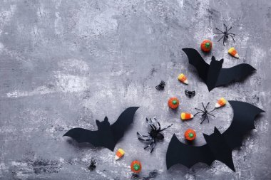Halloween paper bats on grey background
