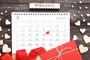 Valentine day calendar with wooden hearts and gift box stock vector