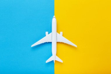 Airplane model on colorful paper background stock vector