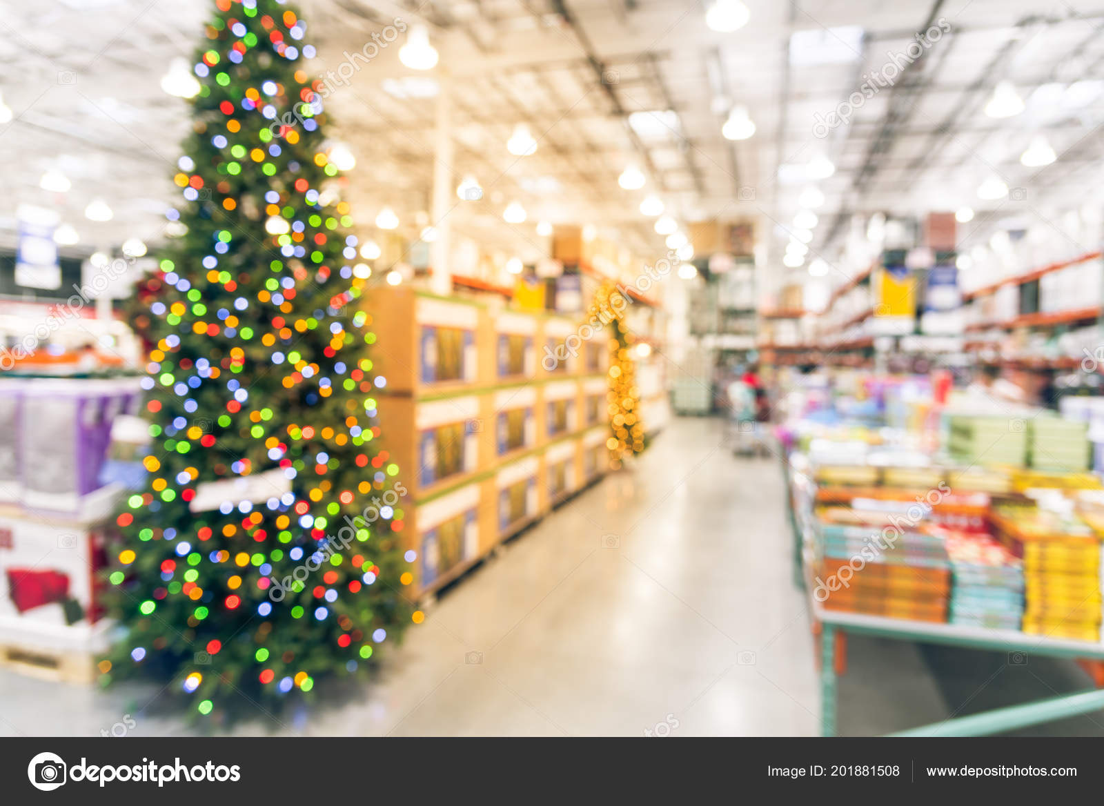 vintage blurred huge christmas tree decoration wholesale store customer shopping stock photo