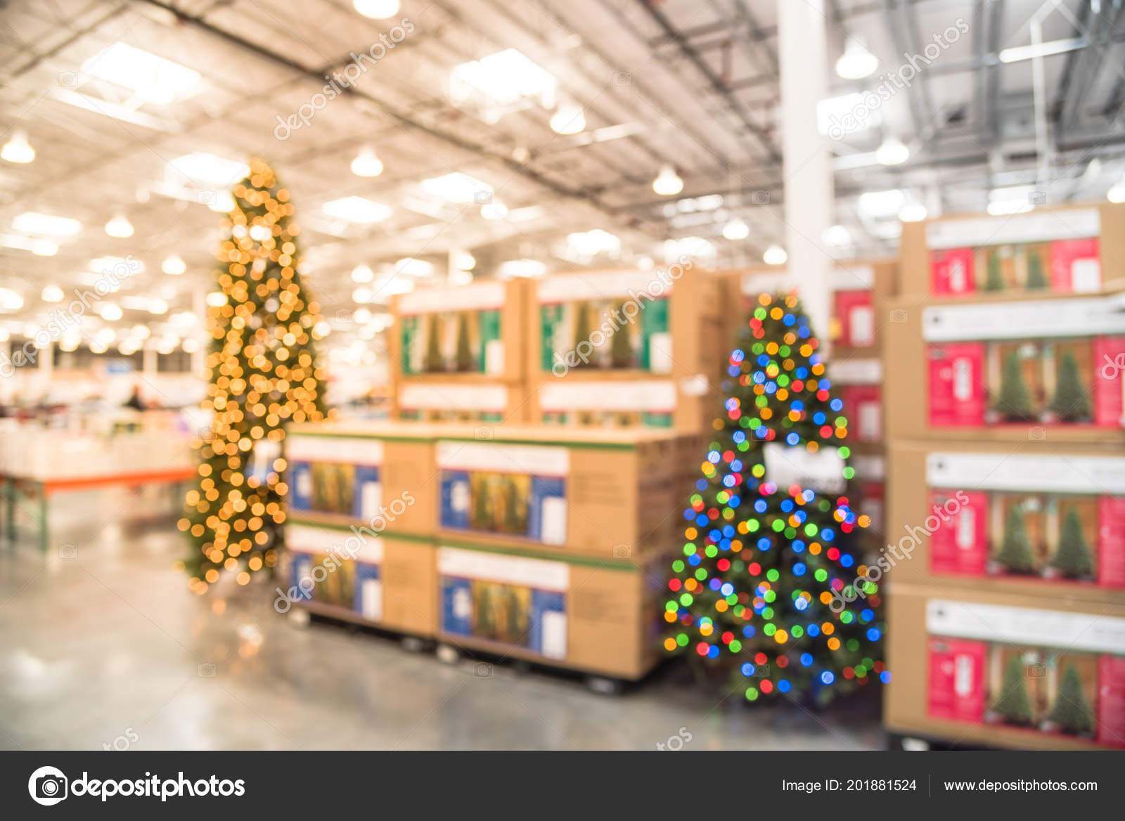 blurred image huge christmas tree decoration in wholesale store wreaths and strings of bokeh lights surround the artificial christmas tree - Christmas Wreath Decorations Wholesale