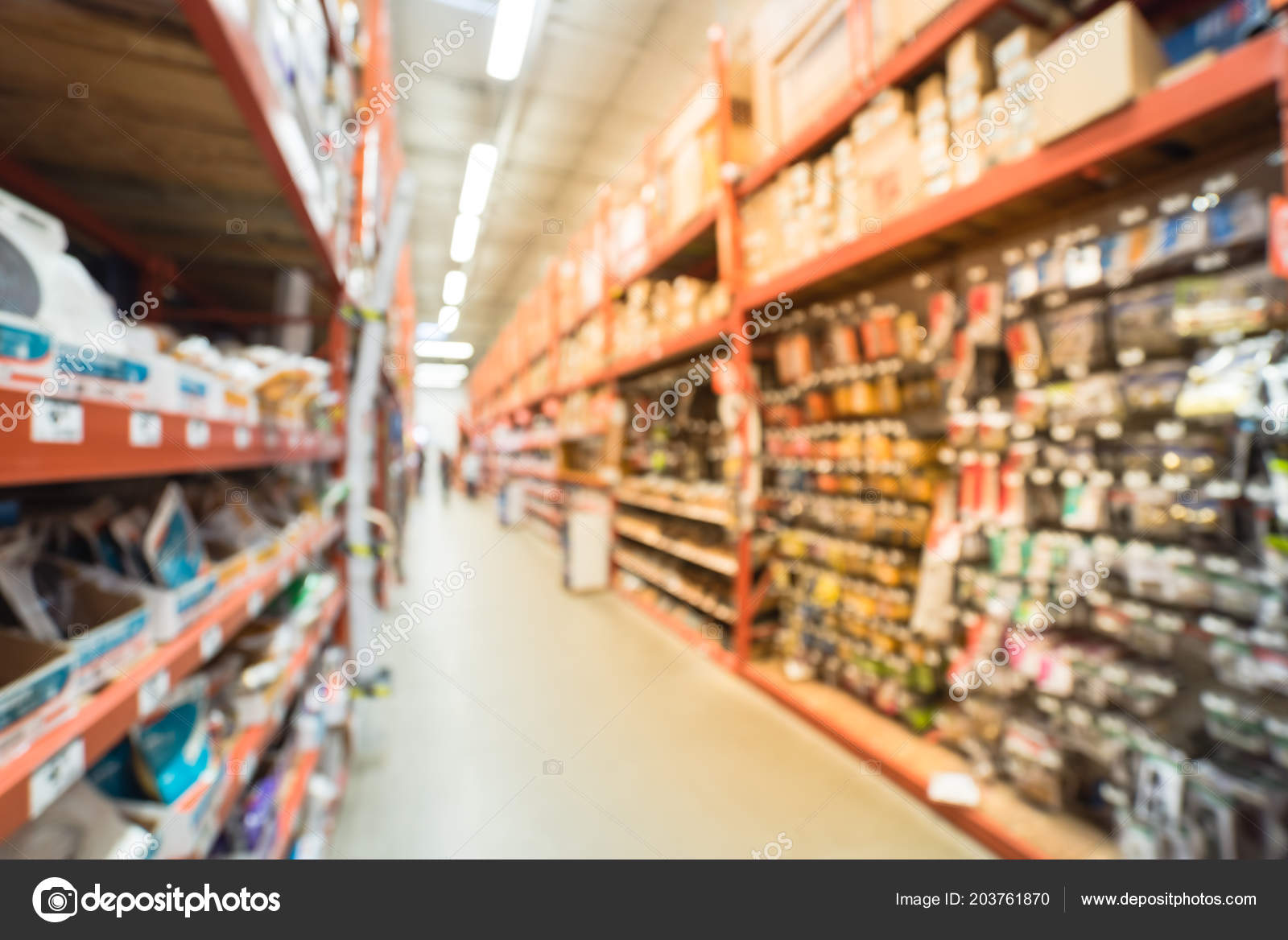Superieur Blurred A Large Hardware Store, Tools And Material. Defocused Interior Of  Home Improvement Retailer With Racks Of Door Hardware, Weather Proofing And  ...