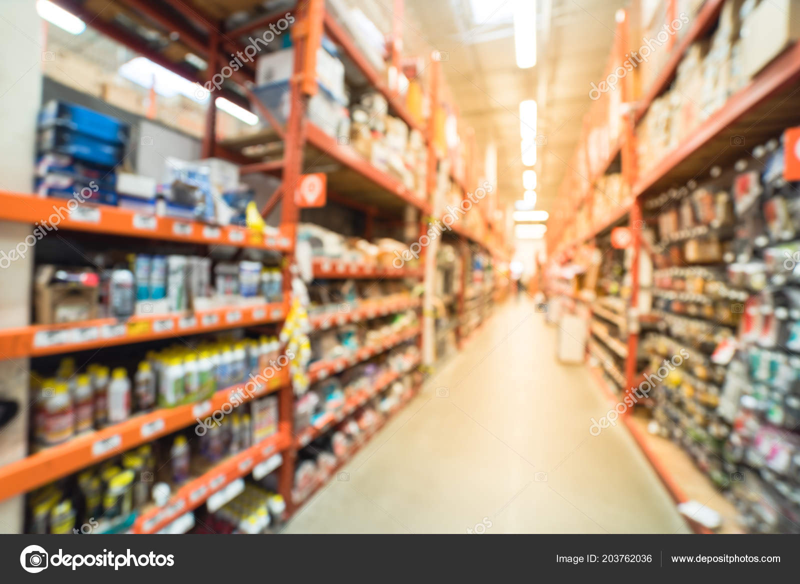 Blurred A Large Hardware Store, Tools And Material. Defocused Interior Home  Improvement Retailer With Racks Of Door Hardware, Weather Proofing And  Lockset ...