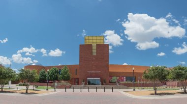 FORT WORTH, TX, US-AUG 5,2018:Panoramic view facade entrance of Fort Worth Museum of Science and History under cloud blue sky. Located on 1600 Gendy Street in city Cultural District