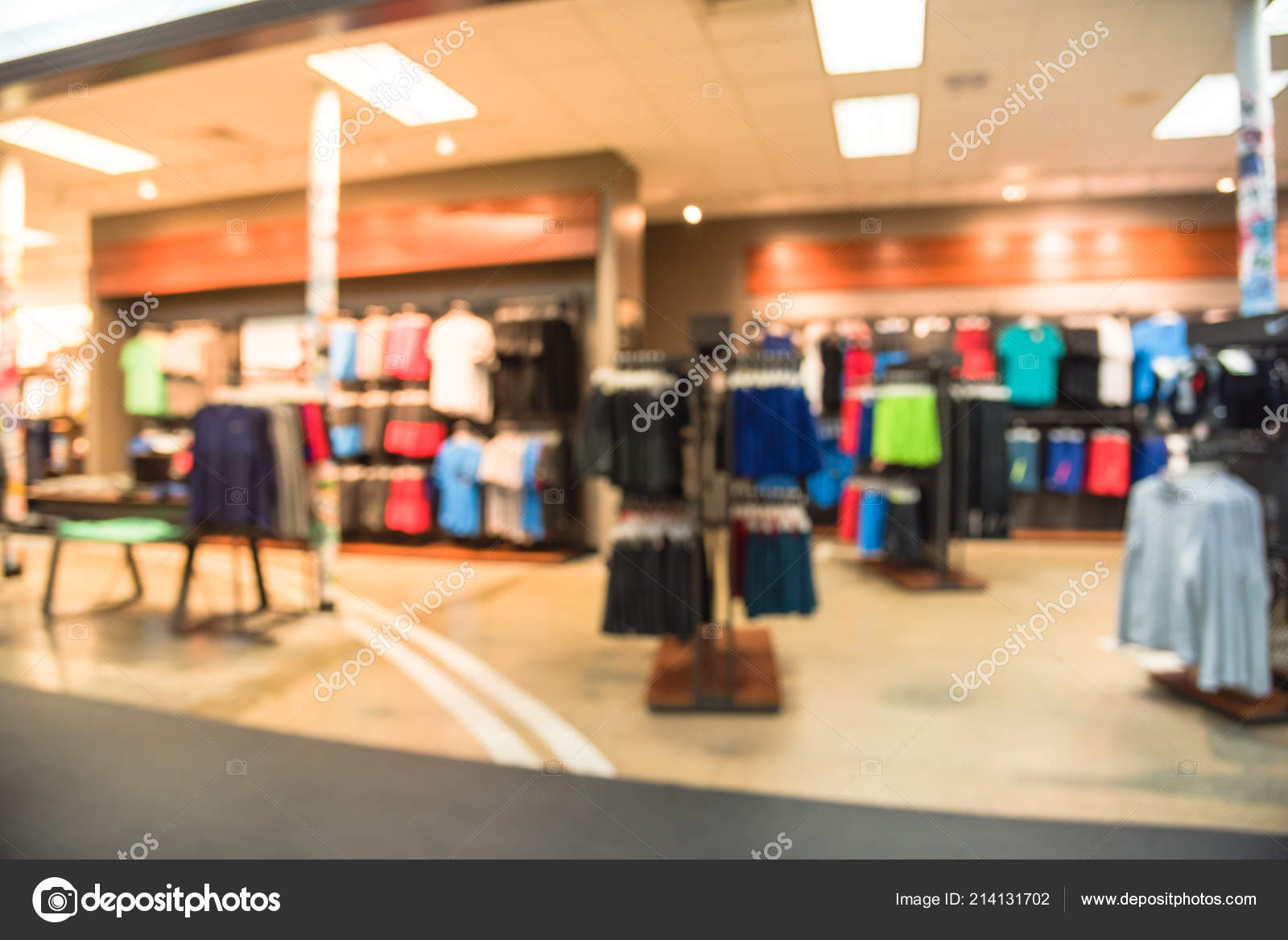 fbc39cb3da01d Blurred image interior of sports and fitness clothing store in America. Sport  shop with famous sports fashion brand worldwide of athletic shoes, ...