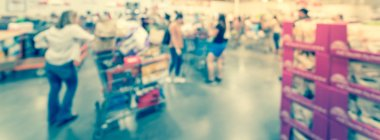 Panoramic view blurry background busy checkout line at wholesale big-box store in America