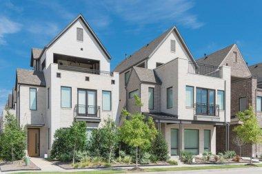 Modern porch of new development three story single family houses near Dallas, Texas