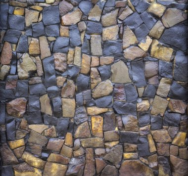 Dry old stone wall texture background close up
