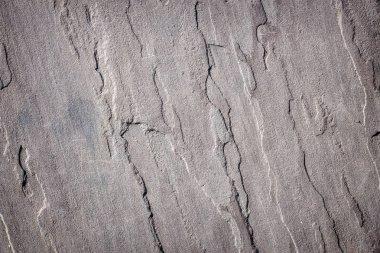 Layers of sedimentary rock on a rugged coastal shoreline.