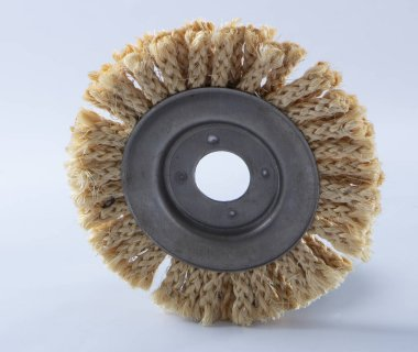 Sisal circle for angle grinder, used for polishing wood and metals, on white background
