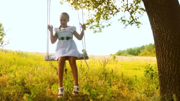 Swinging under the oak tree