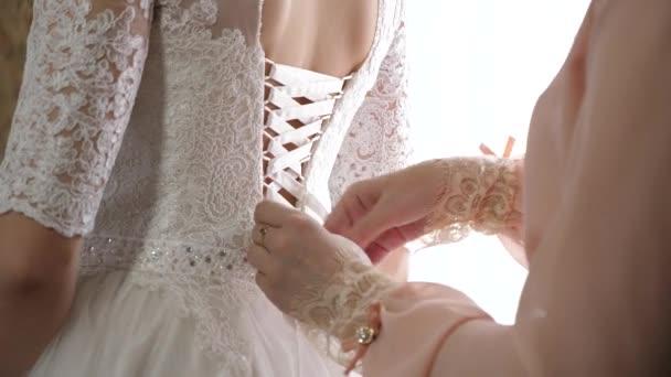 girl dresses beautiful white dress for the wedding