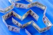 Fotografie Labyrinth of money 100 dollars on a blue background