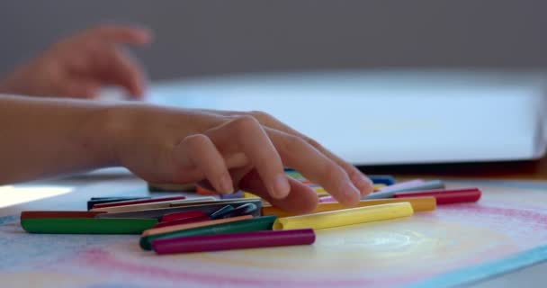 close-up footage of teen girl drawing at home