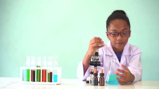 Young African American kid doing chemistry experiment