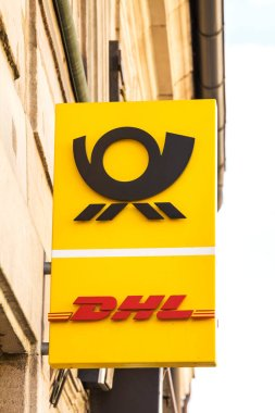 Postbank and DHL service sign on a building
