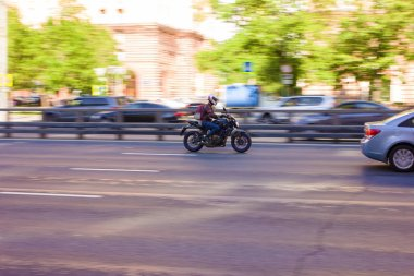 Motorcyclist rides at high speed on the highway The photo was taken on the Prospekt Mira metro station in Moscow, spring 2019, Moscow, motorbike, Avenue, car.