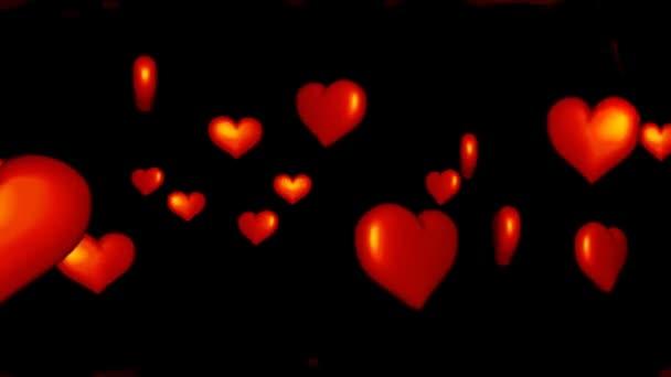 mozgó színes háttéren világos piros szívek